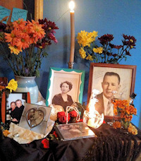 Juana Bordas' Día de Los Muertos altar with pictures of her mother and father.